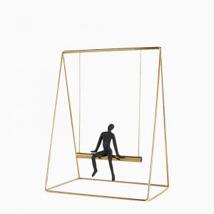 man-on-swing-small - desk-decor